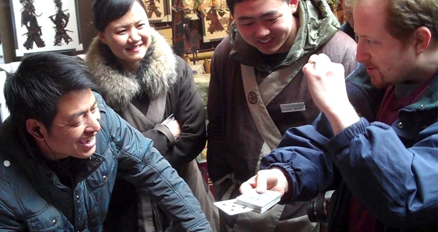 Image of Chinese people enjoying the card magic of Lee Asher